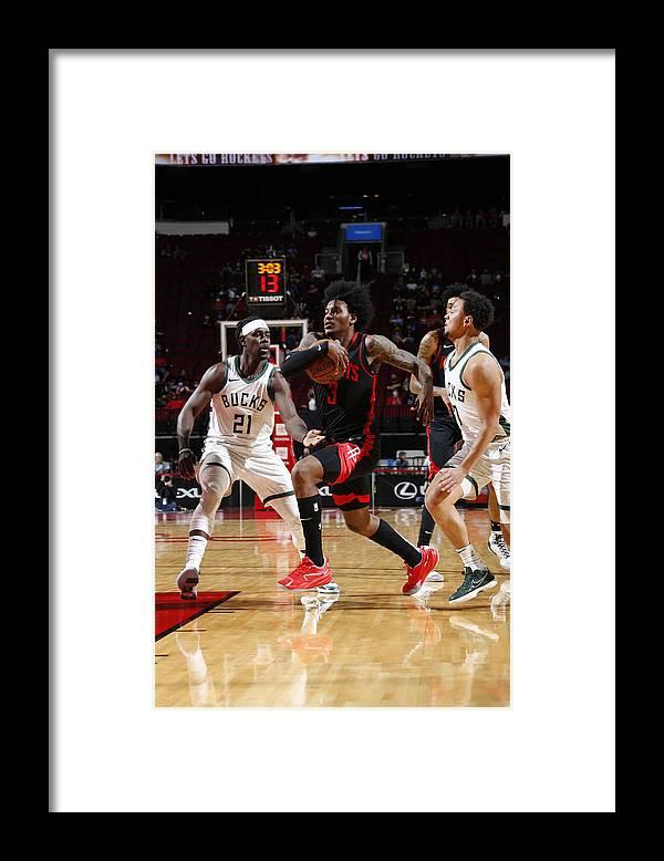 Nba Pro Basketball Framed Print featuring the photograph Milwaukee Bucks v Houston Rockets by Troy Fields