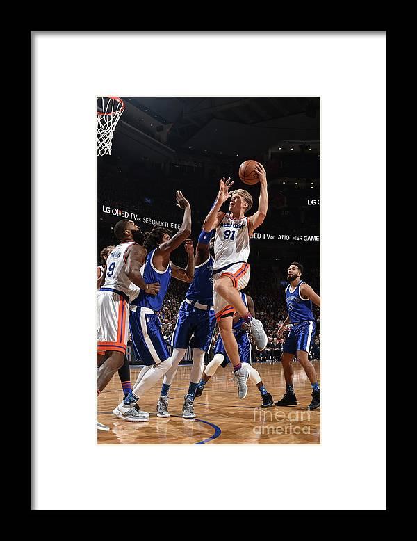 Nba Pro Basketball Framed Print featuring the photograph Mindaugas Kuzminskas by Ron Turenne