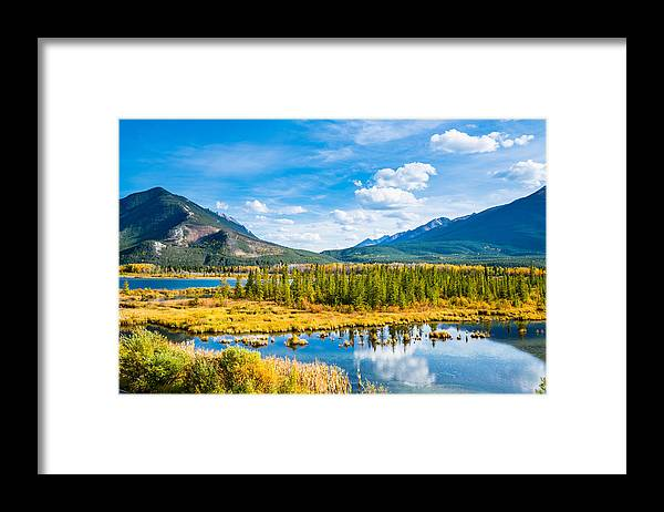 Tranquility Framed Print featuring the photograph Minnewanka lake in Canadian Rockies in Banff Alberta Canada by WanRu Chen