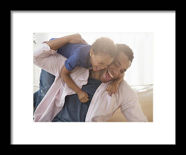4-5 Years Framed Print featuring the photograph Mixed race father and son playing on sofa by Jose Luis Pelaez Inc