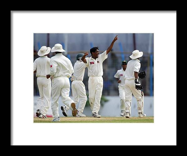 International Match Framed Print featuring the photograph Mohammad Rafique of Bangladesh celebrates by Clive Rose