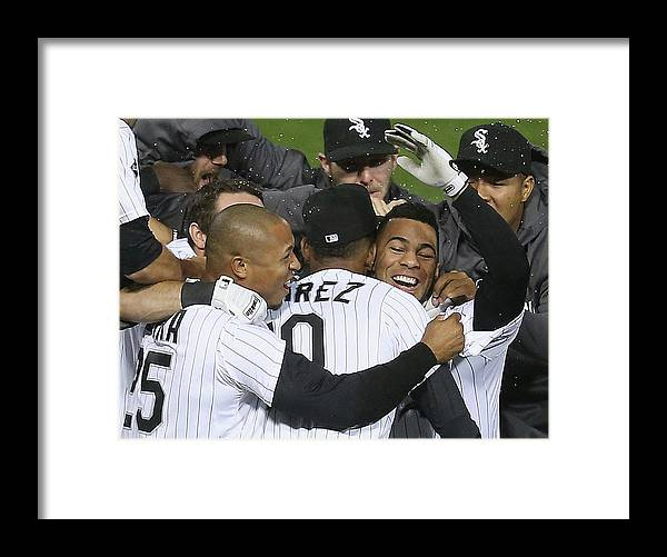 American League Baseball Framed Print featuring the photograph Moises Sierra and Alexei Ramirez by Jonathan Daniel