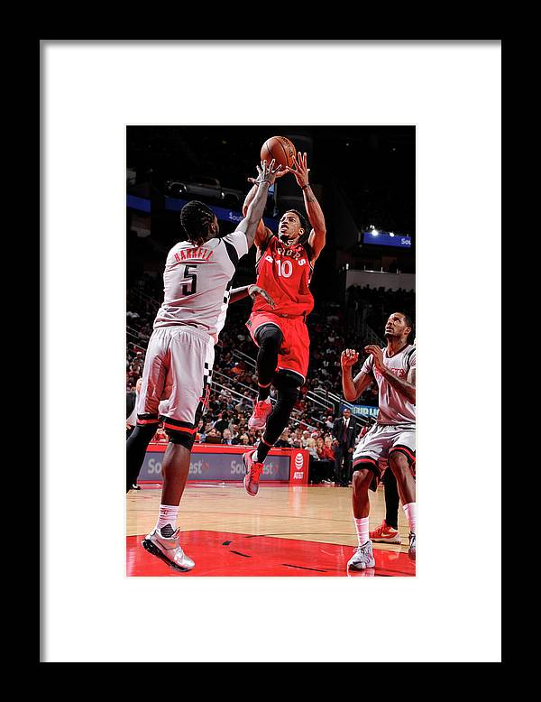 Nba Pro Basketball Framed Print featuring the photograph Montrezl Harrell and Demar Derozan by Bill Baptist
