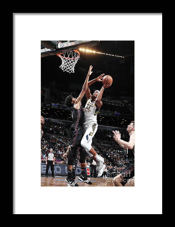Nba Pro Basketball Framed Print featuring the photograph Myles Turner by Nathaniel S. Butler