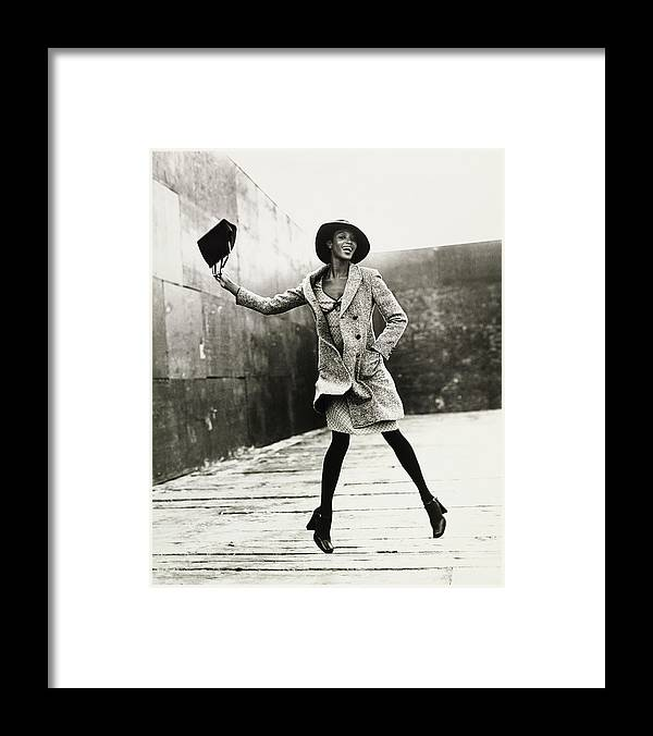 Black And White Framed Print featuring the photograph Naomi Campbell Jumping in the Air by Arthur Elgort