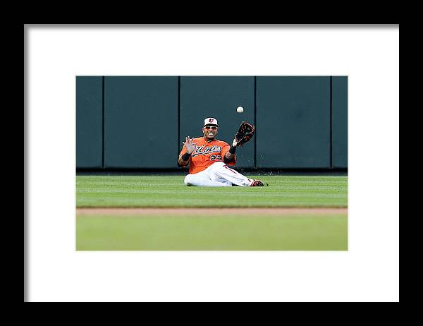 American League Baseball Framed Print featuring the photograph Nelson Cruz and Josh Thole by Jonathan Ernst