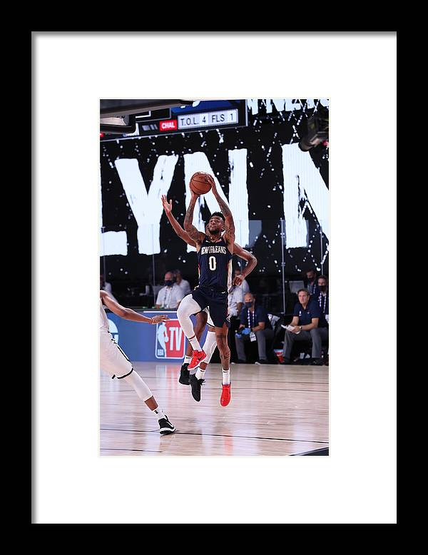 Nba Pro Basketball Framed Print featuring the photograph New Orleans Pelicans v Brooklyn Nets by Joe Murphy