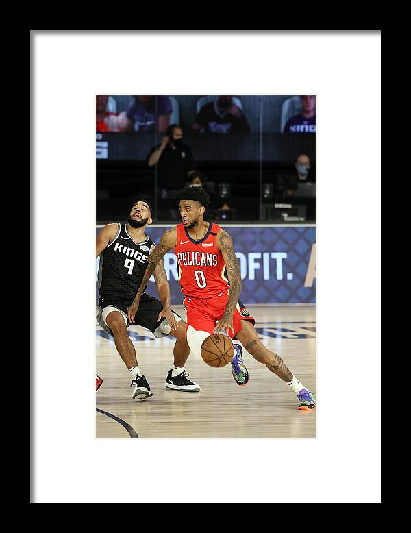 Nba Pro Basketball Framed Print featuring the photograph New Orleans Pelicans v Sacramento Kings by Joe Murphy