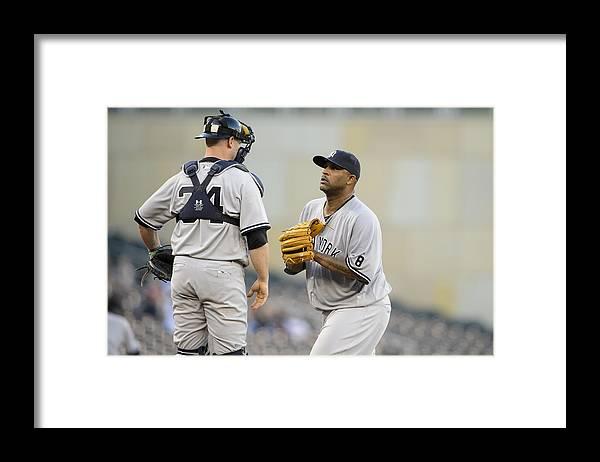 Brian Mccann Framed Print featuring the photograph New York Yankees v Minnesota Twins by Hannah Foslien