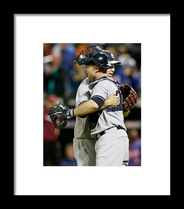 Brian Mccann Framed Print featuring the photograph New York Yankees V New York Mets by Elsa
