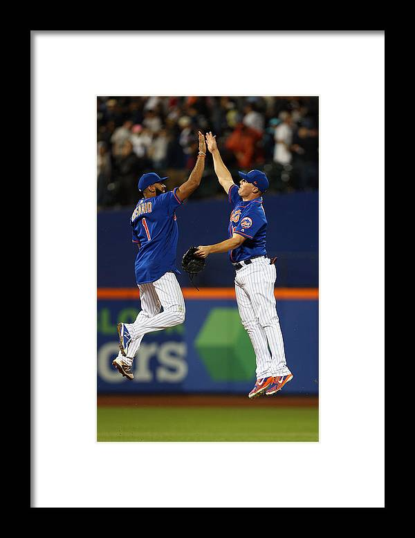 People Framed Print featuring the photograph New York Yankees v New York Mets by Rich Schultz