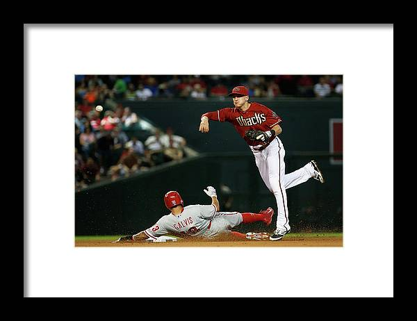 Double Play Framed Print featuring the photograph Nick Ahmed and Freddy Galvis by Christian Petersen
