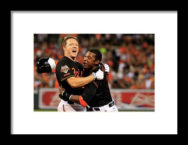 American League Baseball Framed Print featuring the photograph Nick Hundley and Adam Jones by Rob Carr