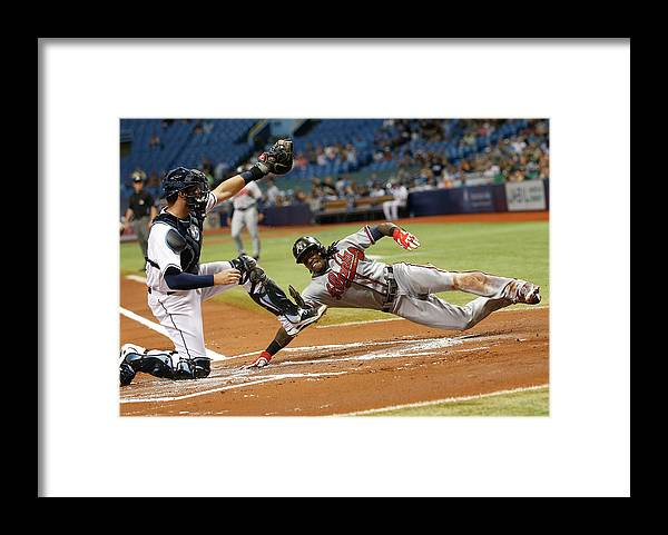 Baseball Catcher Framed Print featuring the photograph Nick Markakis and Cameron Maybin by Brian Blanco