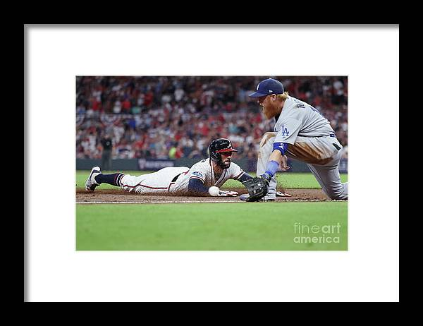 Atlanta Framed Print featuring the photograph Nick Markakis and Justin Turner by Rob Carr