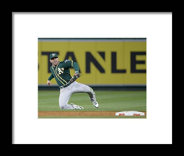 Second Inning Framed Print featuring the photograph Nick Punto and Chris Iannetta by Harry How