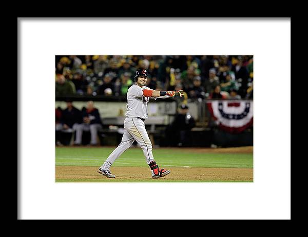 American League Baseball Framed Print featuring the photograph Nick Swisher and Nyjer Morgan by Ezra Shaw