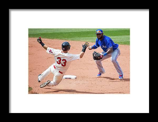 American League Baseball Framed Print featuring the photograph Nick Swisher, Jose Reyes, and Jason Kipnis by Jason Miller