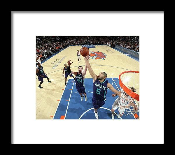 Nicolas Batum Framed Print featuring the photograph Nicolas Batum and Frank Kaminsky by Nathaniel S. Butler