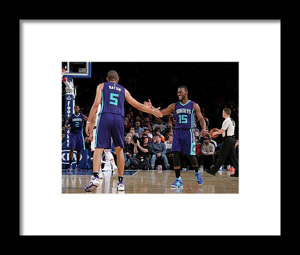 Nicolas Batum Framed Print featuring the photograph Nicolas Batum and Kemba Walker by Nathaniel S. Butler