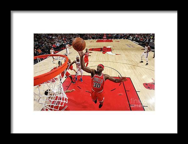 Nba Pro Basketball Framed Print featuring the photograph Noah Vonleh by Gary Dineen