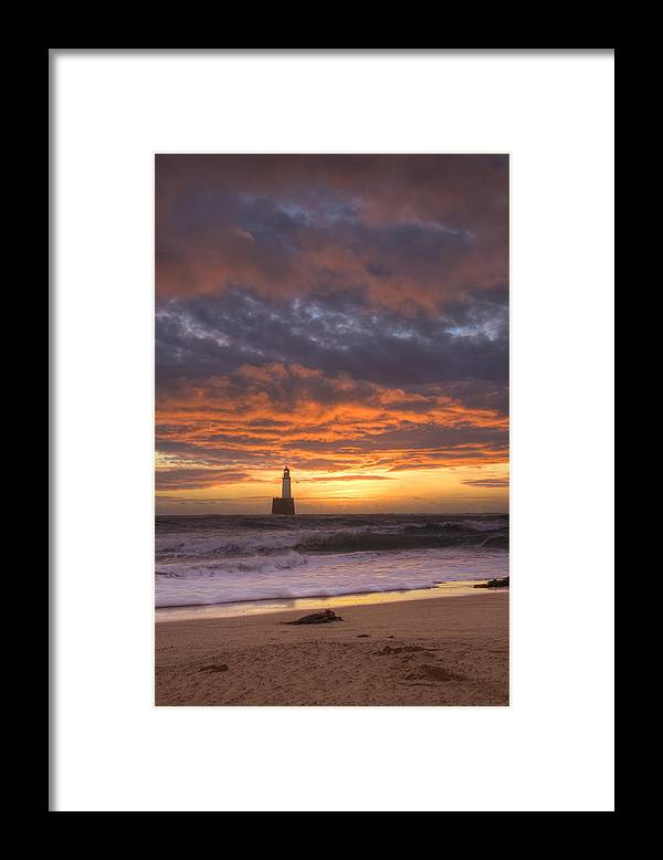 Water's Edge Framed Print featuring the photograph North Sea Lighthouse At Dawn by Theasis