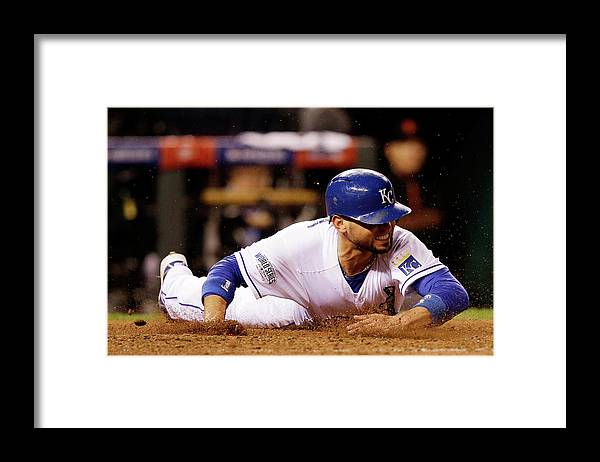 People Framed Print featuring the photograph Omar Infante and Alcides Escobar by Ezra Shaw
