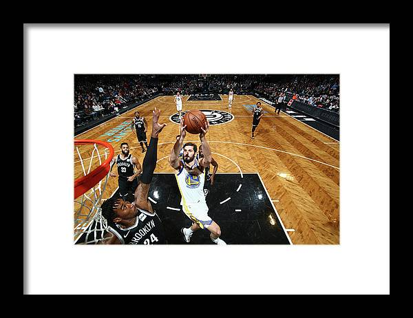 Nba Pro Basketball Framed Print featuring the photograph Omri Casspi by Nathaniel S. Butler