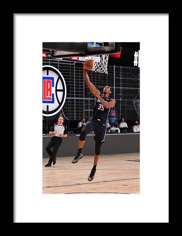 Nba Pro Basketball Framed Print featuring the photograph Orlando Magic v Los Angeles Clippers by Jesse D. Garrabrant
