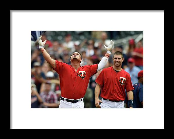 Oswaldo Arcia Framed Print featuring the photograph Oswaldo Arcia and Joe Mauer by Hannah Foslien