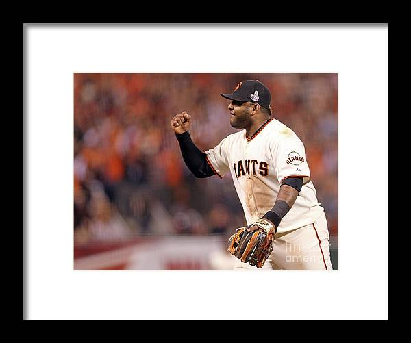 Game Two Framed Print featuring the photograph Pablo Sandoval and Gerald Laird by Christian Petersen
