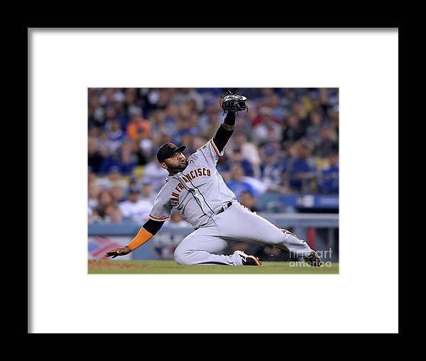People Framed Print featuring the photograph Pablo Sandoval and Yasiel Puig by Harry How