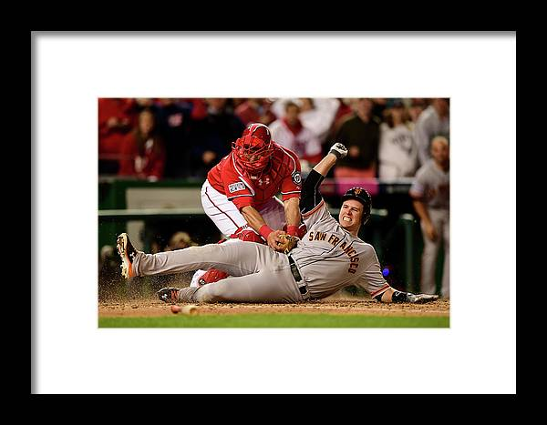Game Two Framed Print featuring the photograph Pablo Sandoval, Wilson Ramos, And Buster Posey by Patrick Smith