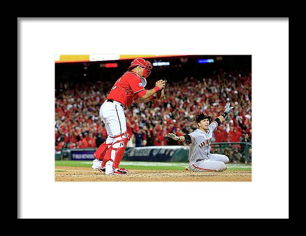 Game Two Framed Print featuring the photograph Pablo Sandoval, Wilson Ramos, and Buster Posey by Rob Carr
