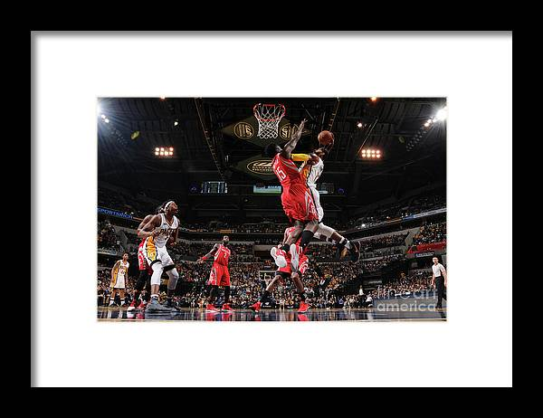 Nba Pro Basketball Framed Print featuring the photograph Paul George and Clint Capela by Ron Hoskins