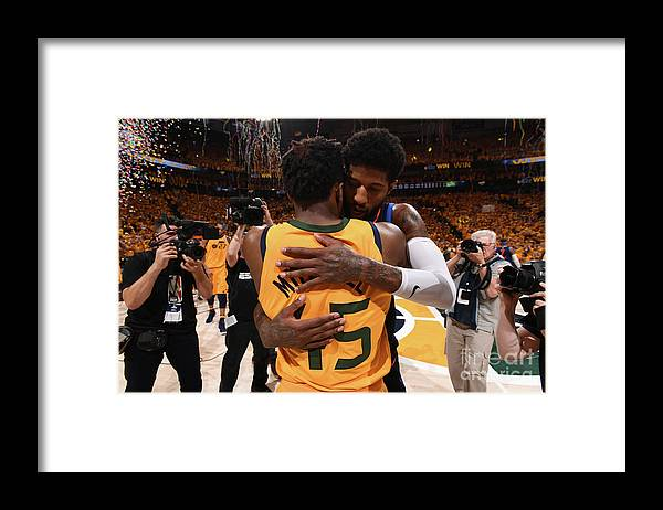 Playoffs Framed Print featuring the photograph Paul George and Donovan Mitchell by Garrett Ellwood