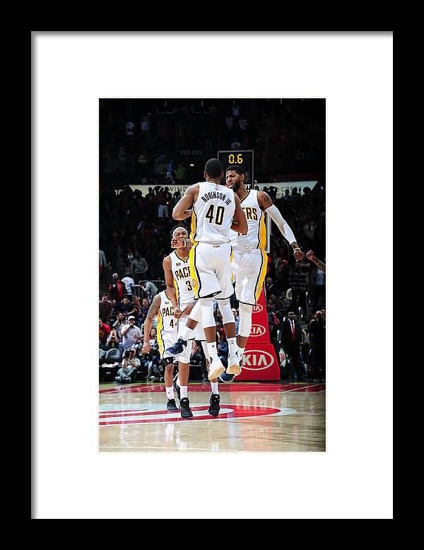 Atlanta Framed Print featuring the photograph Paul George and Glenn Robinson by Scott Cunningham