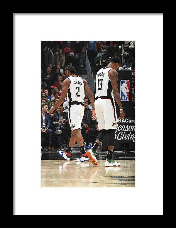 Nba Pro Basketball Framed Print featuring the photograph Paul George and Kawhi Leonard by Andrew D. Bernstein