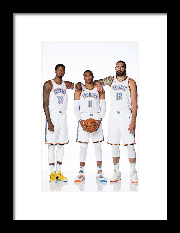 Media Day Framed Print featuring the photograph Paul George, Russell Westbrook, and Steven Adams by Nba Photos