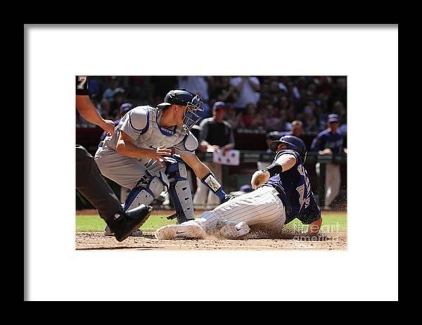 Baseball Catcher Framed Print featuring the photograph Paul Goldschmidt and Austin Barnes by Christian Petersen