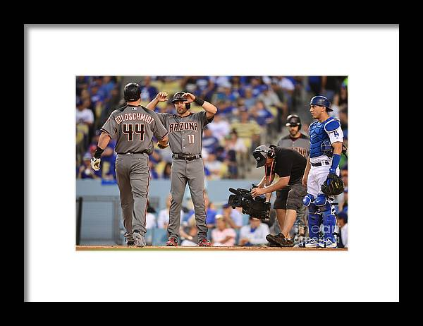 Game Two Framed Print featuring the photograph Paul Goldschmidt and Austin Barnes by Harry How