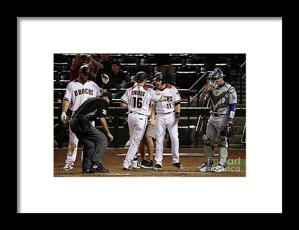 Ninth Inning Framed Print featuring the photograph Paul Goldschmidt and Chris Owings by Christian Petersen