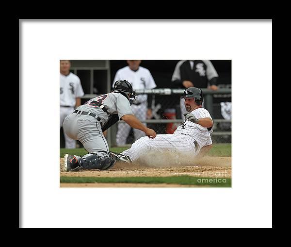 American League Baseball Framed Print featuring the photograph Paul Konerko and Alex Avila by Jonathan Daniel