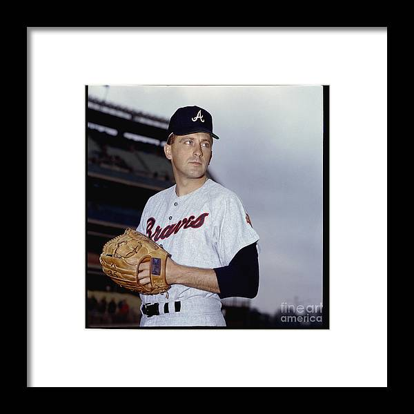 Baseball Pitcher Framed Print featuring the photograph Phil Niekro by Louis Requena