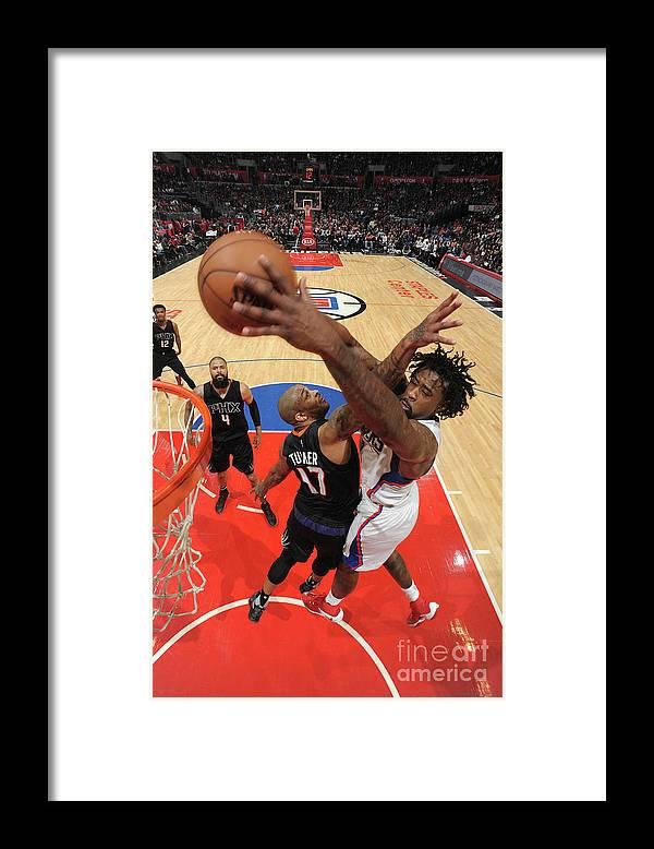 Nba Pro Basketball Framed Print featuring the photograph P.j. Tucker and Deandre Jordan by Andrew D. Bernstein
