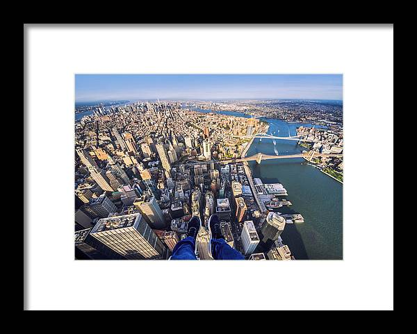 Lower Manhattan Framed Print featuring the photograph Pov Of Human Leg With Manhattan Skyline From Helicopter by Eloi_Omella