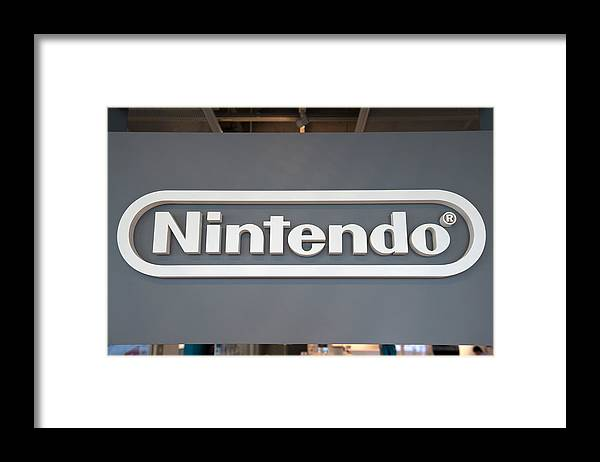 Corporate Business Framed Print featuring the photograph Product Displays Inside The Nintendo Game Front Showroom by Bloomberg