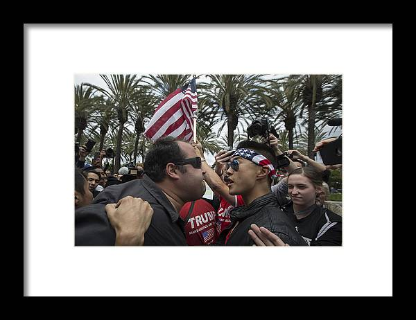 Democracy Framed Print featuring the photograph Protestors Rally Outside Trump Campaign Event In Anaheim by David McNew