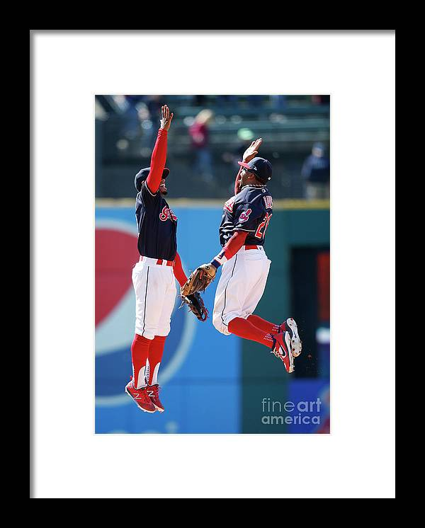 People Framed Print featuring the photograph Rajai Davis and Francisco Lindor by Ron Schwane
