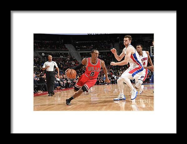 Nba Pro Basketball Framed Print featuring the photograph Rajon Rondo by Chris Schwegler